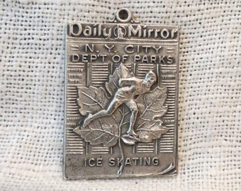 Dieges & Clust Daily Mirror New York Department of Parks Ice Skating Pendant Medal Sterling Silver 1952