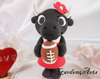 NEW--Custom baby shower cake topper - Lovely baby MASCOT holding a football and circle clay base - Chinese Zodiac