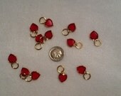 Red Swarovski crystal heart charms in gold plate bezel setting