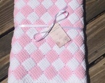 light pink and white checkered crocheted baby blanket or lap throw, entrelac crocheted blanket