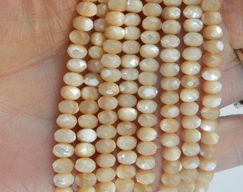 4x6mm Natural mother of pearl  faceted   rondelle beads .  FULL STRAND (15.5 inches)