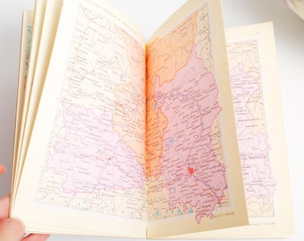 Vintage world map book Atlas issued in Soviet Union on 1980s. In Russian