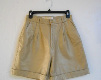 Vintage 1980s TWINS LEATHER INC. metallic gold pleated leather cuffed shorts, size 6