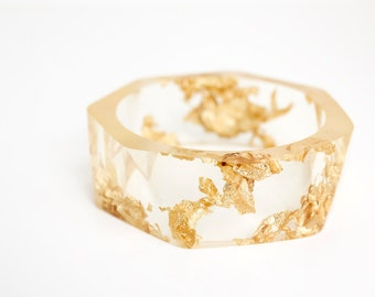 clear gold resin bangle made with eco resin containing gold flakes with large triangle facets