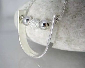 Sterling Silver U-Shaped Moving Bead Pendant Necklace - Designed And Handmade By CMcB Jewellery UK