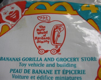 Bananas Gorilla in Busy World of Richard Scarry Yellow Toy Car and Grocery Store Front Unopened New in Pkg McDonald's Happy Meal Collectible