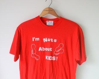 Vintage RAD Tee....size large xlarge...hipster. screen prints. ball. funny tee. fathers day. creepy. nuts about kids. rare vintage. hipster