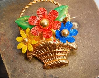 Vintage brass filigree brooch, basket with flowers.