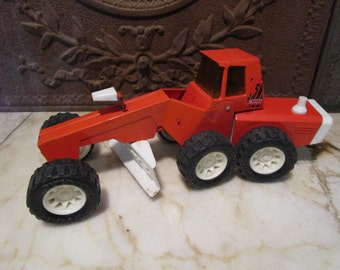 Vintage orange and white 'BUDDY L' road grade with 'Swivel engine compartment!