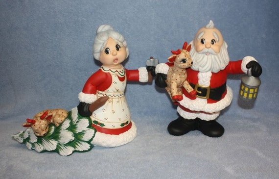 Handpainted Ceramic Santa Claus Holding A Baby Deer And Mrs