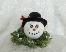 Shop now for Christmas Holiday Primitive Snowman  Head on Greenery