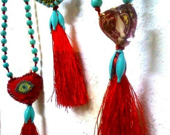 B612 beaded rosario necklace turquise coloured howlite talisman red tassel