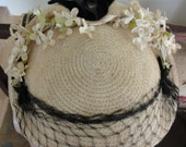 Antique weaved mini hat with netting, velvet bow, and flowers