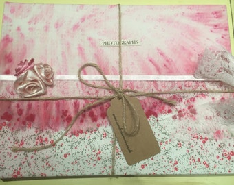 pink floral fabric covered photo album