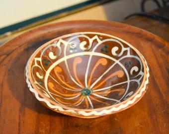 Small Soufflenheim Pottery Bowl, brown glaze with orange and white design