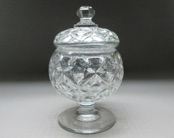 Flint glass footed sugar bowl with lid , Four Petal pattern , made between 1830 - 1840