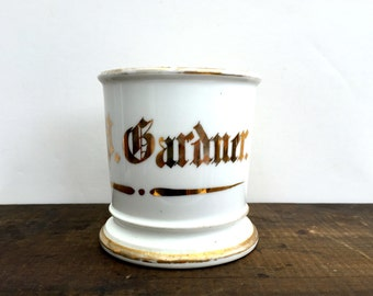 Old shaving mug with owner's name painted on