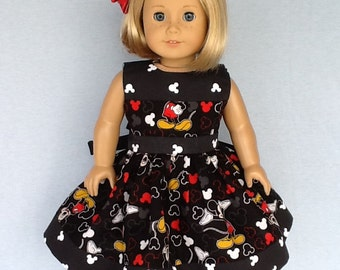 18 inch doll dress and hair clip.   Fits American Girl  doll. Novelty print.