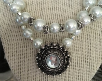 Antique look necklace made of pearls and silver chain with vintage centerpiece