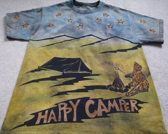 Bear camping under a starry night, roasting a marshmallow, tent, campfire, coyote howling, man's large discharged, dyed and printed t-shirt