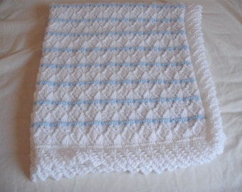 hand knitted baby blanket in white and blue Marriner DK wool