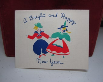 Sweet and colorful 1930's art deco Norcross happy new year greeting card boy and girl wearing european traditional folk clothing dancing