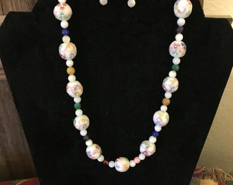 Flower pastel necklace and earring set.