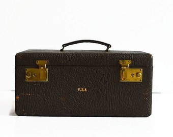 vintage leather train makeup case with key 1940s