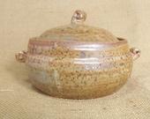 Stoneware individual Casserole pot, with shino glaze.