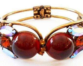 """Weiss Cuff Bracelet Signed Cherry Amber & Aurora Purple Rhinestones Gold Metal 1"""" Vintage"""