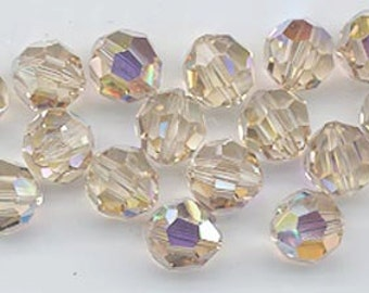 24 gorgeous Swarovski crystals - art 5000 - 6 mm - discontinued color ceylon topaz AB