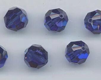 Twelve Swarovski crystals - Art. 5000 - 8 mm - non-standard color dark sapphire AB