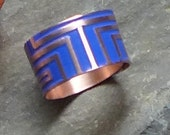 Cobalt blue and copper geometric ring