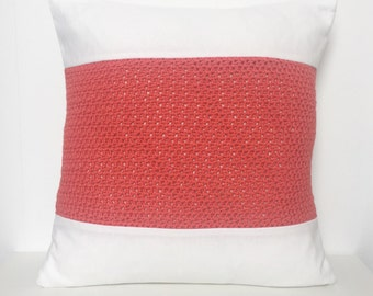 White pillow with rusty red crochet panel