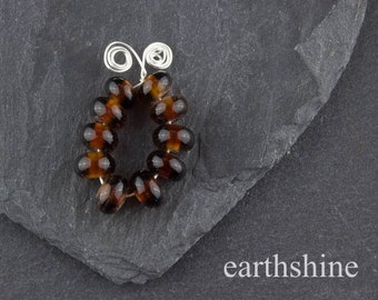 10 dark amber handmade glass lampwork spacer beads.