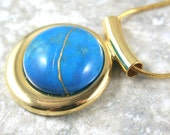 Kintsugi (kintsukuroi) turquoise howlite stone pendant with gold repair in a gold plated setting on gold chain - OOAK