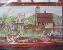 "Live Simple, Be Content, NIP counted cross stitch kit, Plaid Bucilla #45657, Janet Stever design, 2011, 20.5"" X 12"", folksy rural farm scene"
