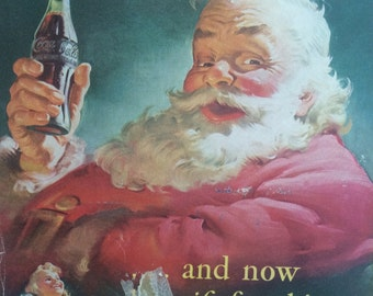 Original 1950s Coca-Cola advert. Iconic Coke advertising. This ad features a Father Christmas and 2 cute kids.