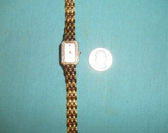 One (1), Ladies, Diamond Bezel, Mother of Pearl Dial, Bracelet Watch from Seiko.