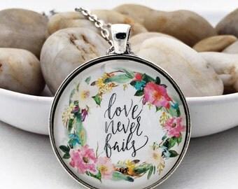 Love never fails 1 Corinthians 13:8 glass pendant necklace silver bronze silver pink mint flower Scripture jewelry Bible verse handwritten