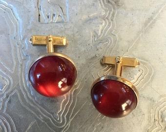 Vintage Swank Cufflinks with dark red cabachon in gold tone