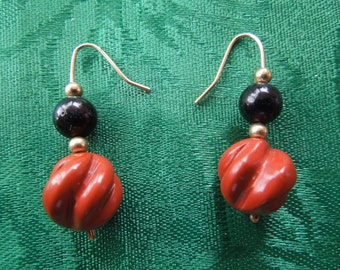 Vintage Hook Earrings for Pierced Ears.  Dangle Type Hard Plastic Brown and Black Swirls with Gold Tone Spacers