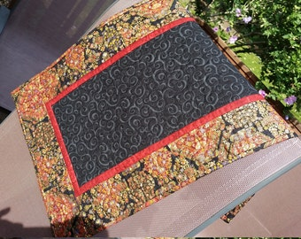 Black, gold, red quilted table runner