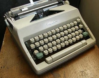 superb Olympia cream with two green keys manual typewriter with case,2.green keys , cream body 1970s, Free UK postage