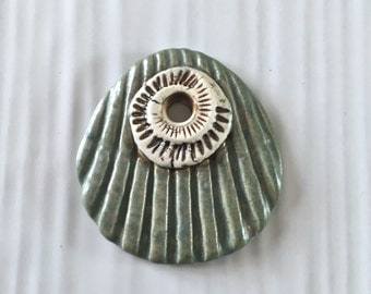 Handmade ceramic shell and ammonite pendant, ammonite pendant
