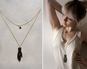 Clay 'Tarot' necklace - black hand amulet pendant long gold chain