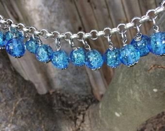 Blue glow in the dark bead bracelet with silver