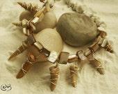 Princess Mononoke fossilized shark teeth necklace.