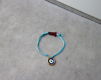 Baby blue eye bracelet, sky blue cord and  enameled, brass eye charm bracelet, Greek eye boho bracelet, unique macrame evil eye bracelet