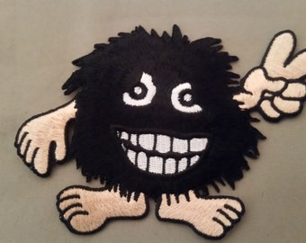 Long haired monster peace patch